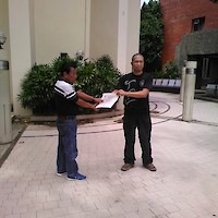 Alvin receiving promotion to Lakan Apat from SGM Caburnay.